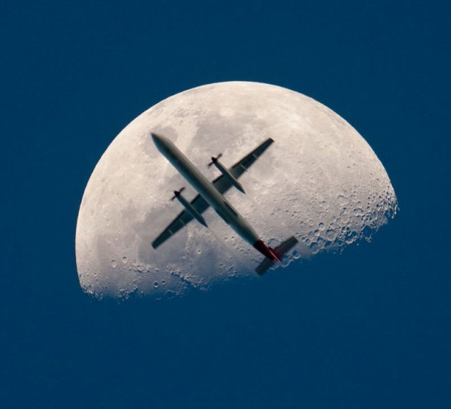 airplane-passing-the-mooon-perfect-timing